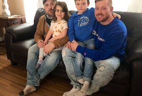 From left, sitting, are Jeremy Tanner and Troy Currie, who are splitting the $15,000 cost for a Cape Breton man to attend the two-month treatment program at Together We Can, a substance use disorder treatment facility in Vancouver. With them are their children, from left, Ava and Jaxson, who are both four and are big inspirations in the two men's recovery from addiction. NICOLE SULLIVAN/CAPE BRETON POST