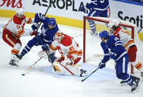 Calgary Flames goalie Jacob Markstrom makes a save on Maple Leafs' Alex Galchenyuk during the second period in Toronto on Tuesday, April 13, 2021.