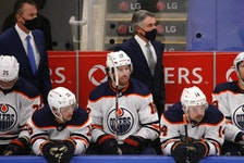 Edmonton Oilers coach Dave Tippett mans the bench against the Toronto Maple Leafs on Jan. 22, 2021.