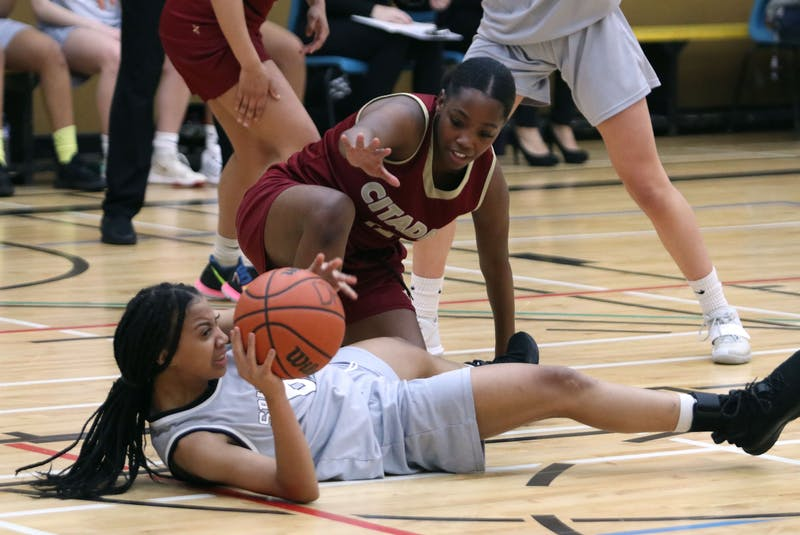 Dartmouth's Denezz Beals eyeballs a pass to a Spartans teammate after gaining control of the loose ball from Kendra Gannon of the Citadel Phoenix during the Capital Region girls' basketball championship Tuesday at Dartmouth High. - Eric Wynne / The Chronicle Herald - Eric Wynne