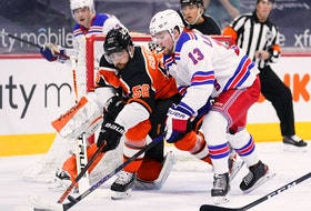 Philadelphia Flyers' Erik Gustafsson (56) and New York Rangers' Alexis Lafrenière (13) battle for the puck during the second period on Feb. 24, 2021, in Philadelphia.