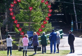 FOR MASS SHOOTING ANNIVERSARY COVERAGE: People stop to look at the large heart memorial, made with names of those killed in the Nova Scotia mass shooting and placed at the trail head in Victoria Park in Truro, NS Wednesday April 14, 2021.  TIM KROCHAK PHOTO