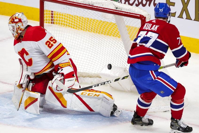 Montreal Canadiens defenceman Brett Kulak scores a goal against Calgary Flames' Jocob Markstrom during second period in Montreal on April 14, 2021.