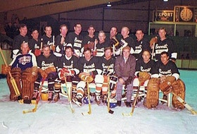 Truro District Hockey League players in black sweaters, front row, left to right, Bill McNutt, Jack Hepburn, Ronnie Conrad, Ronnie Fielding, Ivan Weatherbee, coach Chet Totten, Gerald (Chub) Bartlett and Hughie Hutchinson. Back row, Jackie Dale, Billy Hepburn, Lick MacDonald, Jack Cameron, Les Topshee, Larry Ward, Gordie  Blair, Doug Pender, Keith Miller, Gordie Lynds and Dick Huggard.