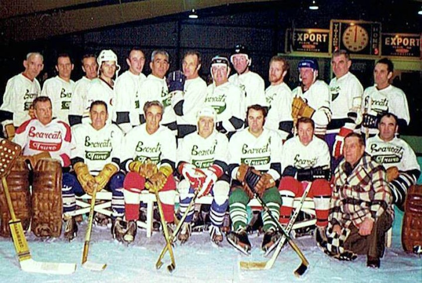 TDHL players in white sweaters, front row, left to right, Ken (Dutchy) Mumford, Billy McIntyre, Gerry Pender, Laurie Totten, Ronnie MacCormack, Donnie Moore, coach Irving (Chub) Bartlett and Rollie Stevens. Back row, George Tobin, Kent Brenton, Charlie Toole, Mike McGill, Ronnie Moore, Raymond Cope, Charlie Hill, Charlie Rutherford, Cecil Caudle, Ernie Maynard, Freddie Osborne, Jigs Dickey and Bert MacLaren. - Contributed