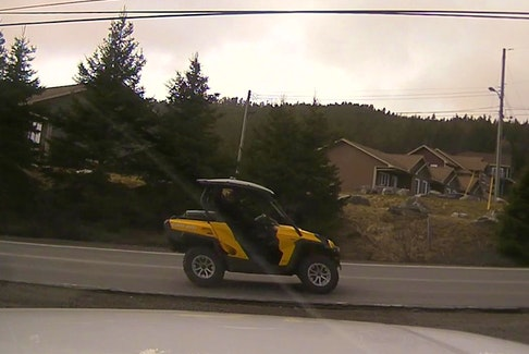 RCMP attempted to pull over this ATV shown in a picture taken by a camera in a police cruiser parked on Route 70 in Spaniard's Bay Tuesday afternoon. — Submitted photo/RCMP
