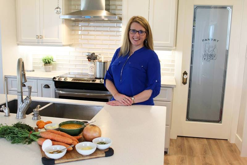 St. John's nutritionist Tara Antle is encouraged the hear of the locally produced meal boxes being distributed by Melinda and Brad Simmonds. - File Photo