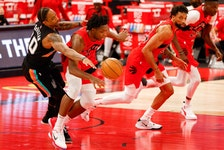 San Antonio Spurs forward DeMar DeRozan (10) knocks the ball away from Toronto Raptors forward OG Anunoby during the second quarter on Wednesday night at Amalie Arena.