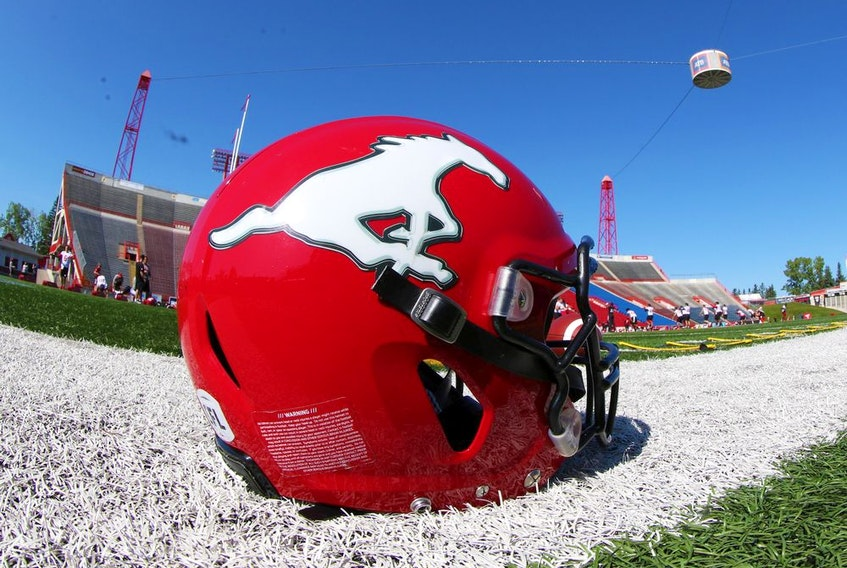 A Calgary Stampeders helmet and football rest on the sidelines during practise at McMahon Stadium in Calgary, Thursday August 15, 2019. Gavin Young/Postmedia