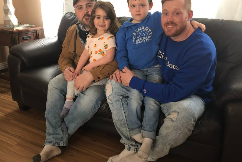 From left, sitting, are Jeremy Tanner and Troy Currie, who are splitting the $15,000 cost for a Cape Breton man to attend the two-month treatment program at a Together We Can, a substance use disorder treatment facility in Vancouver. With them are their children, from left, Ava and Jaxson, who are both four and both big inspirations in the two men's recovery from addiction. NICOLE SULLIVAN/CAPE BRETON POST