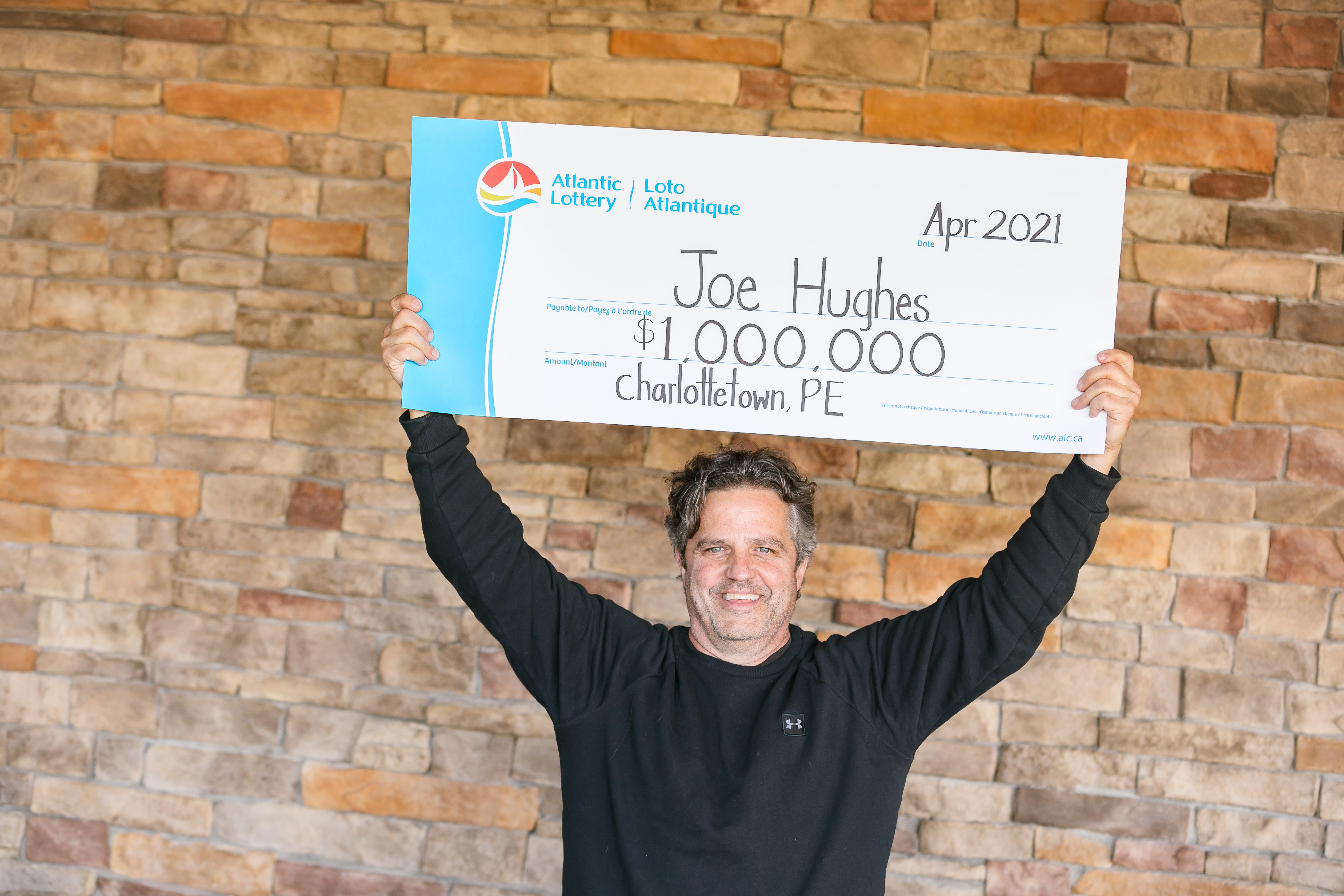 Joe Hughes walked into a local convenience store looking for a sandwich. He left with $1 million.