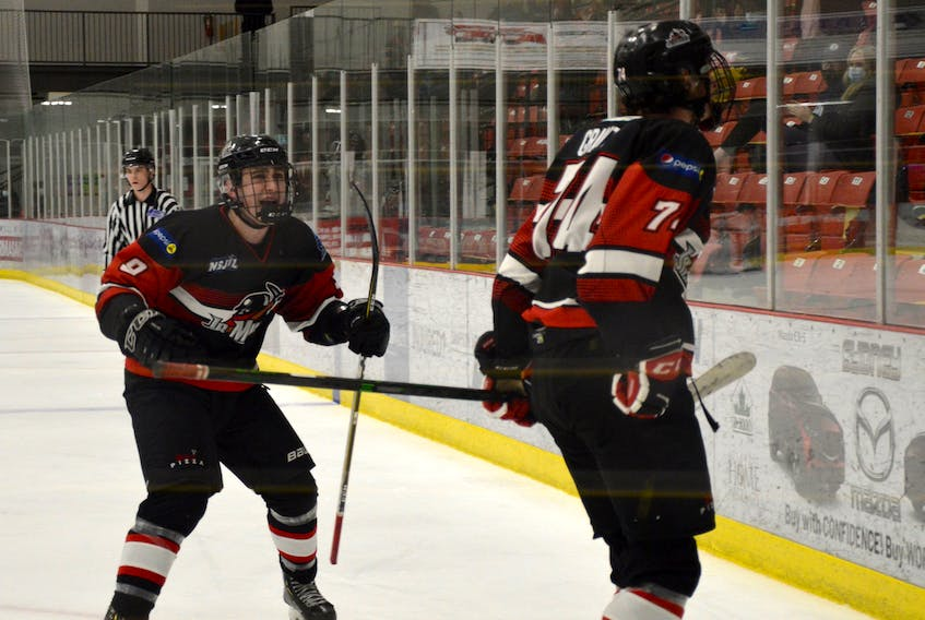 Brandon Grant of the Kameron Jr. Miners, right, celebrates with teammate Alex MacKinnon after scoring a goal during the Nova Scotia Junior Hockey League Sid Rowe Division championship series against the Antigonish AA Munro Bulldogs. The Jr. Miners will play the East Hants Penguins in the league championship, beginning this weekend. JEREMY FRASER • CAPE BRETON POST