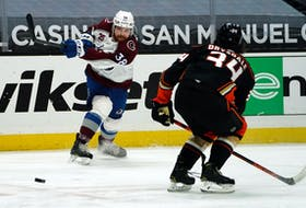 Colorado Avalanche winger Liam O'Brien shoots past Anaheim Ducks defenceman Jamie Drysdale during an April 4 NHL game in Anaheim.
