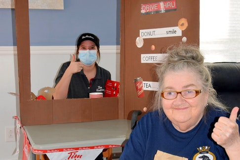 Linda Mayo, President of the Glen Haven Manor Resident Council, was one of the many residents to enjoy the Tim Hortons Drive Thru that was created by Glen Haven in partnership with Pictou County's Tim Hortons. Mayo was served by Recreation Programmer Nicole Blackwood who came up with the idea for this fun event and also coordinated its implementation. KIM DICKSON PHOTO