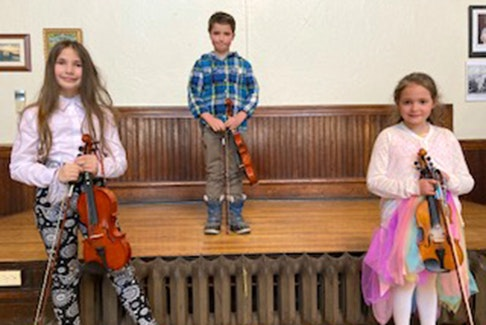 Madeleine Hendsbee, James Gamble and Maelle Melong were participants in fiddle classes at First Presbyterian Church in the New Glasgow Music Festival.