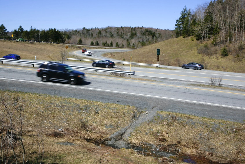 Traffic flows from Highway 101, to and from the Beaver Bank Connector at exit 2 in Lower Sackville Thursday, April 15, 2021. Local residents use a path, seen at lower right, to access the nearby transit terminal after walking through lanes of traffic. - Tim Krochak