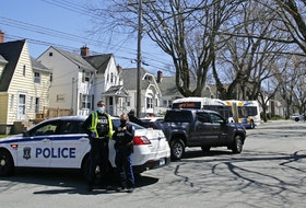 FOR COMMONS STORY: Halifax regional police are seen at the scene of a pedestrian mva at the intersection of Oxford and Liverpool Streets in Halifax  Thursday April 15, 2021.   TIM KROCHAK PHOTO