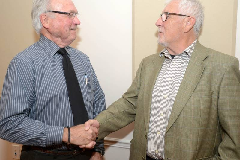 Three Rivers former Mayor Merrill Scott, left, congratulates current Mayor Edward MacAulay following the final public meeting for the Three Rivers interim council in November 2018. - SaltWire Network File