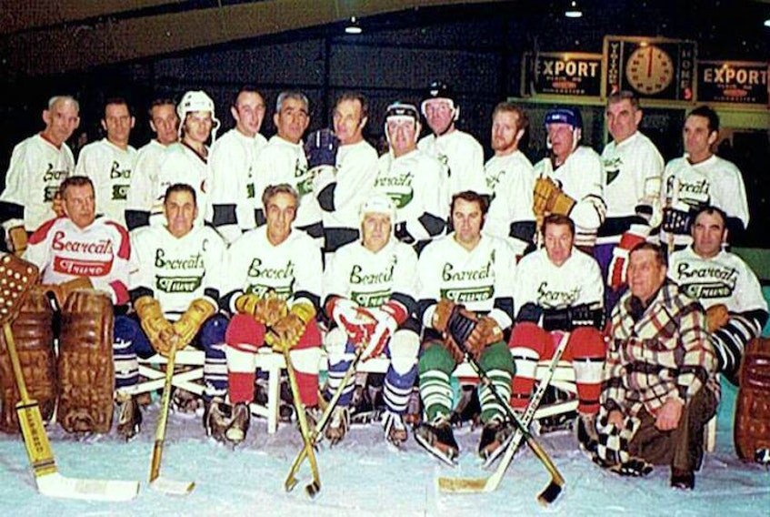 """TDHL players in white sweaters, front row, left to right, Ken """"Dutchy"""" Mumford, Billy McIntyre, Gerry Pender, Laurie Totten, Ronnie MacCormack, Donnie Moore, coach Irving """"Chub"""" Bartlett and Rollie Stevens. Back row, George Tobin, Kent Brenton, Charlie Toole, Mike McGill, Ronnie Moore, Raymond Cope, Charlie Hill, Charlie Rutherford, Cecil Caudle, Ernie Maynard, Freddie Osborne, Jigs Dickey and Bert MacLaren."""