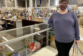 Karen McKinnon of Maritime Mosaic stands by a nearly empty case that was one of two that had jewelry, valued at more than $50,000, stolen during a break-in at the former Dayle's Grand Market in downtown Amherst on March 23.