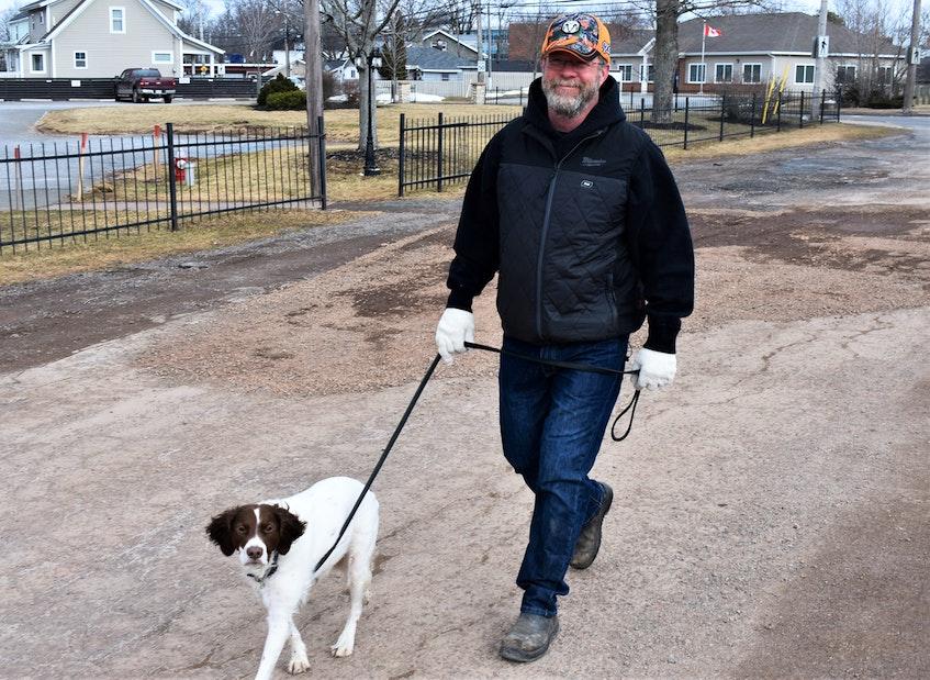 Randy Crosby walking his dog Rhys on the Cobequid Trail - an active transportation plus in Truro. - Richard MacKenzie/SaltWire Network