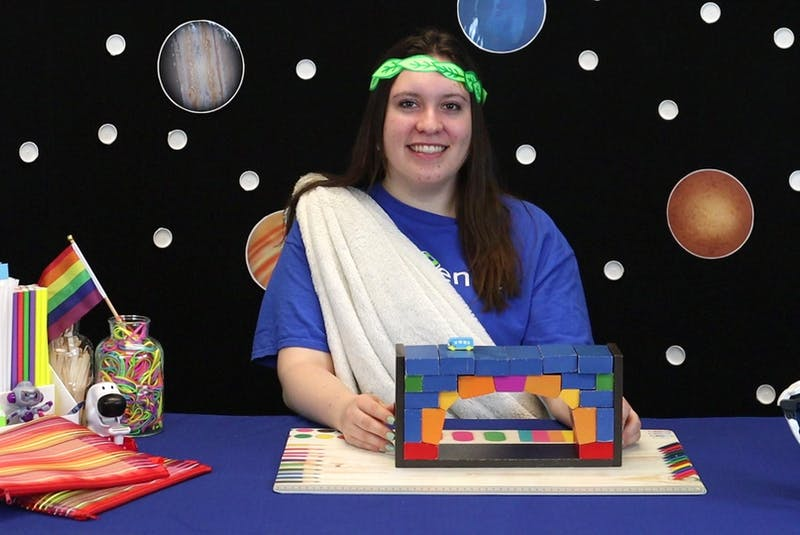 Victoria Somerton, one of five volunteer science educators, records an instructional video for the Let's Talk Science Club: At Home Edition dressed as a Roman as she explains Roman arches and bridge-building. CONTRIBUTED • CBU LET'S TALK SCIENCE