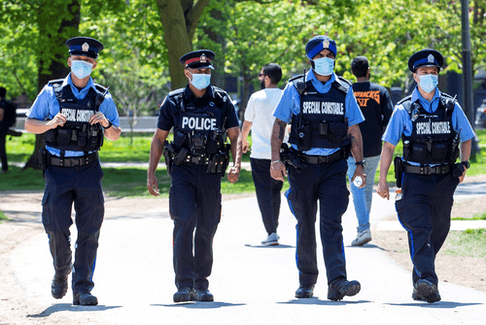 Toronto police and special constables patrol Trinity Bellwoods Park during the COVID pandemic in May 2020.