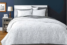 White and neutral tones help to create a relaxing place to snooze during the hot summer months. Hometrends Rose White quilt set, $90, Walmart.ca.