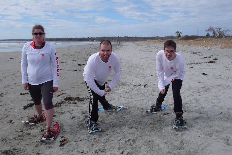 Special Olympians, from left, Emily Latta, of Bridgewater, and Colby Oickle and Michael Moreau, both from Liverpool, are keen to keep up their skills in preparation for the 2022 Special Olympics Winter World Games in Kazan, Russia, even if that means snowshoeing on the decidedly non-winter terrain of Summerville Beach Provincial Park. CONTRIBUTED - CONTRIBUTED