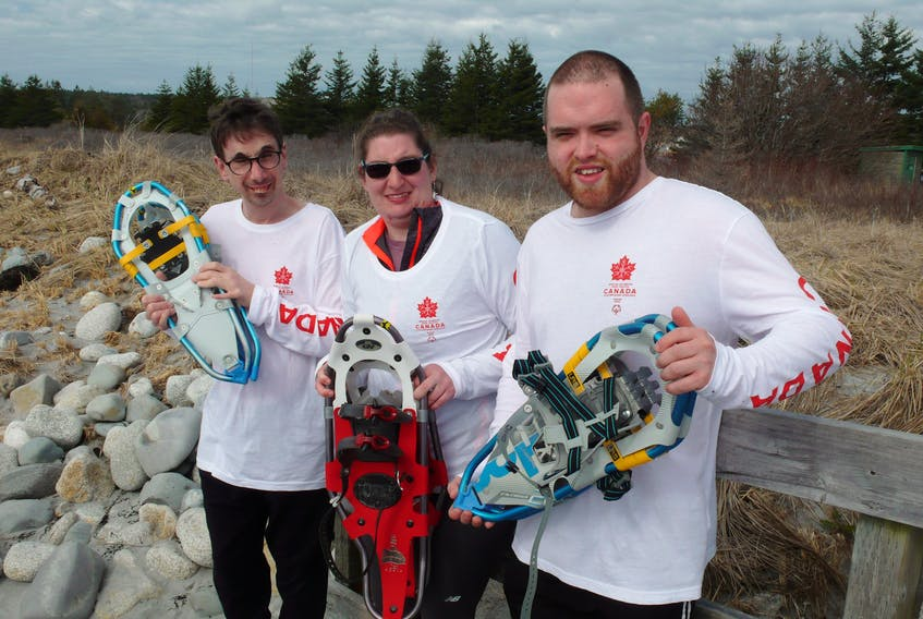 Michael Moreau, left, Emily Latta and Colby Oickle are the only Special Olympians from Nova Scotia who were chosen to represent Team Canada in the 2022 Special Olympics Winter World Games in Kazan, Russia. The three will be part of Team Canada's snowshoeing team. CONTRIBUTED