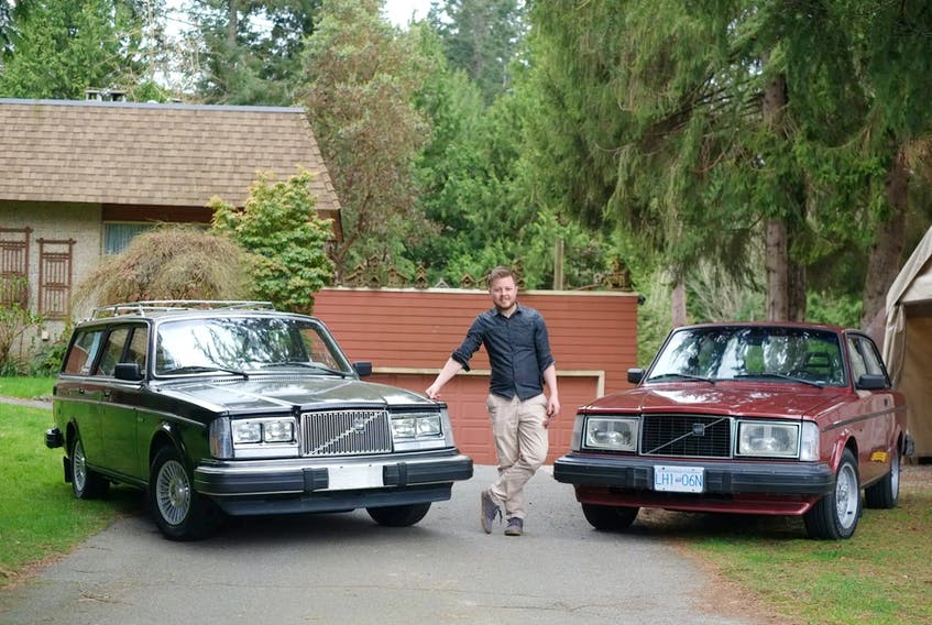 Douglas Peterson-Hui with his cars — Kevin, the 1982 Volvo 245 GL wagon on the left, and Freja, a 1981 Volvo 242 GLT Coupe. Contributed/Douglas Peterson-Hui