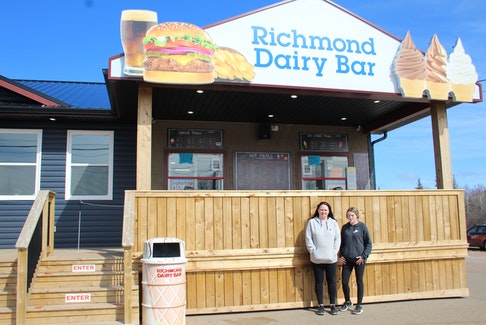 Michelle MacDonald and Cierra Bridges work at Richmond Dairy Bar, where an anonymous man came by and purchased 101 free ice cream cones for kids who came by.