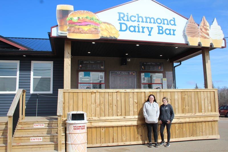 Michelle MacDonald and Cierra Bridges work at Richmond Dairy Bar, where an anonymous man came by and purchased 101 free ice cream cones for kids who came by. - Kristin Gardiner
