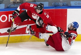 Canada's Dylan Holloway (10) upends Czech Republic's David Jiricek (8) in their IIHF world junior championship quarter-final on Jan. 2, 2021 in Edmonton.