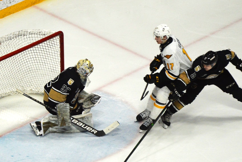 Cole Fraser of the Cape Breton Eagles, middle, gets a shot off on Charlottetown Islanders goaltender Colten Ellis while being pressured by Félix Tremblay during Quebec Major Junior Hockey League action at Centre 200 in Sydney on Friday. Charlottetown won the game 3-2. JEREMY FRASER/SALTWIRE NETWORK