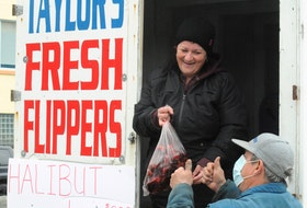 Traffic was steady Friday at Taylor's Fresh Flippers truck on Harbour Drive in St. John's, as vendor Heidi Taylor served up flippers for eager customers. Taylor said she expects to be at the waterfront for the next couple of weeks or so, depending on supply. There was no spring seal hunt last year due to the COVID-19 pandemic. Joe Gibbons/The Telegram