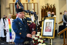 Warrant Officer Scott Pollon plays a closing lament on the pipes at Saturday's memorial service for Prince Philip the Duke of Edinburgh at Halifax's Cathedral Church of All Saints.