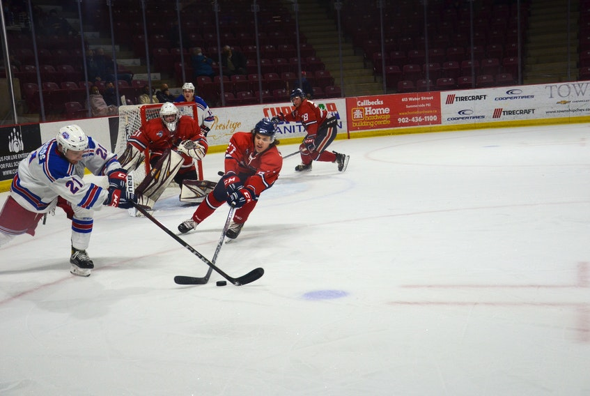 Summerside D. Alex MacDonald Ford Western Capitals forward Cole Edwards, left, and the Valley Wildcats' Dylan Chisholm reach for the puck during Friday night's Maritime Junior Hockey League (MHL) playoff game at Eastlink Arena. The Caps won the game 10-2.
