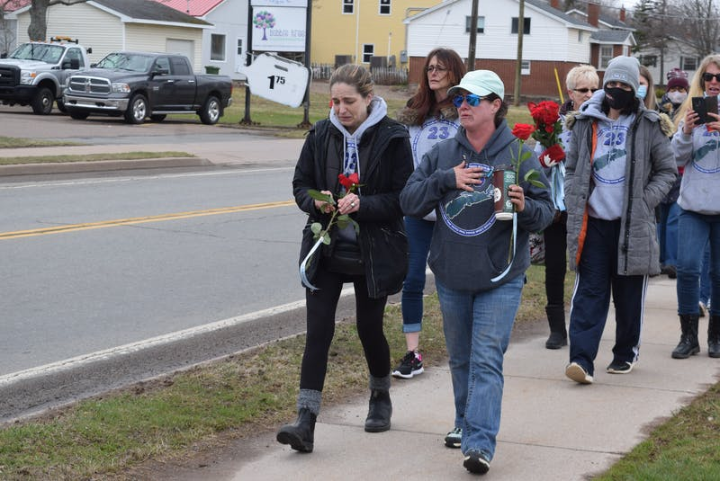 Charlene Bagley, left, and Tara Long, right, shed tears as they lead the march to the RCMP detachment in Bible Hill, N.S. - Chelsey Gould