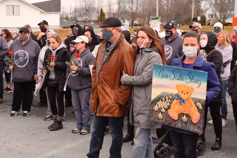 Over 200 people gathered outside of the Colchester County detachment in Bible Hill, N.S. to remember those lost in last year's attacks that killed 22 people and an unborn baby.