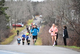 Marathon runners in the Nova Scotia Remembers Memorial Race emerge from the Portapique Loop onto Highway 2 as they make their way to Truro's Victoria Park on Sunday.