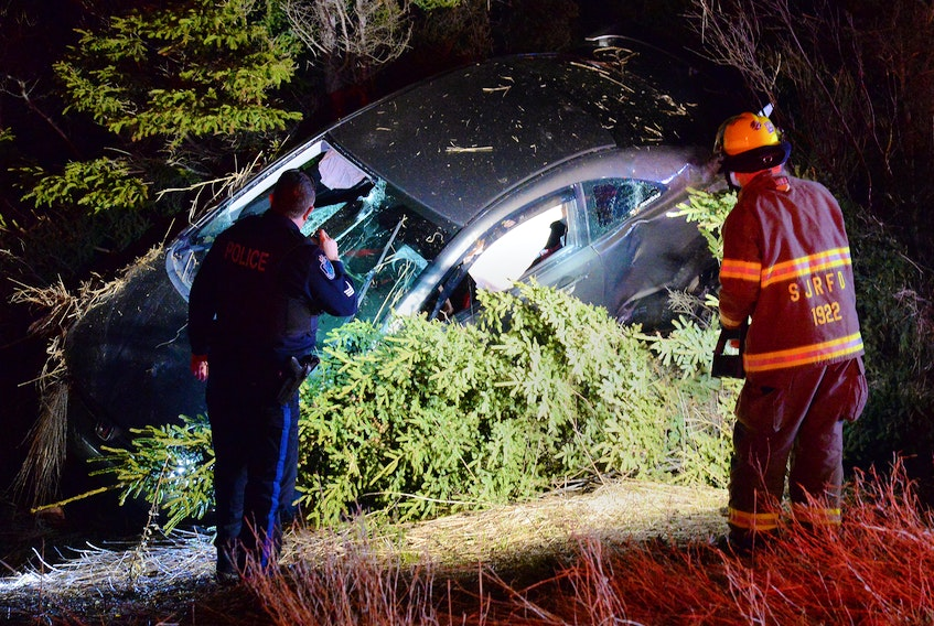 The driver of a car was sent to hospital Sunday morning after his car left the road and overturned into some trees. Keith Gosse/The Telegram