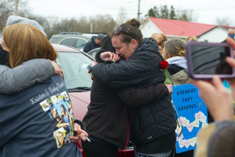 Sarah Jollimore (right) hugs a friend before a march to the RCMP detachment in Bible Hill on Sunday, April 18, 2021. Jollimore's teenage son was Emily Tuck's boyfriend. Emily was one of the people killed in last year's mass shootings. - Ryan Taplin