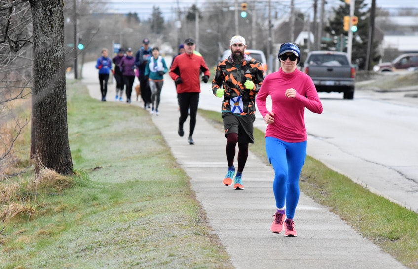 Members of a Yarmouth run club took part in the Nova Scotia Remembers Memorial Run, which saw participation throughout the province on Sunday morning, April 18, to mark the one-year anniversary of the mass shooting tragedy in Portapique a year ago. TINA COMEAU PHOTO - Tina Comeau
