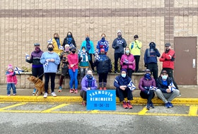Members of a Yarmouth run club gathered on Sunday morning, April 18, to take part in the Nova Scotia Remembers Memorial Run, which saw participation throughout the province to mark the one-year anniversary of the mass shooting tragedy in Portapique a year ago. TINA COMEAU PHOTO