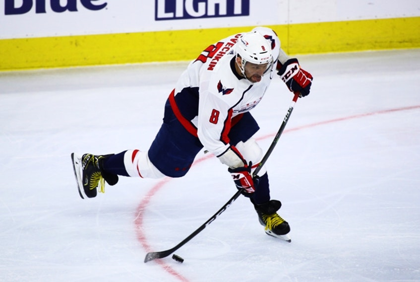 Washington Capitals star Alex Ovechkin takes a shot against the Philadelphia Flyers on Saturday. Ovechkin scored twice in the game and is now just one goal behind tying Marcel Dionne for fifth overall on the all-time NHL scoring list at 731.