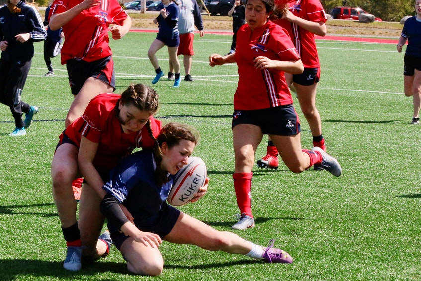 Emily Maynard gets tackled after a decent run from Avon View's end. - Carole Morris-Underhill