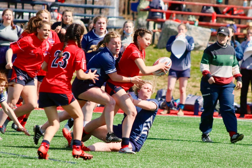 King's-Edgehill's Ava Shearer, from Windsor, is showing some solid rugby skills already. - Carole Morris-Underhill