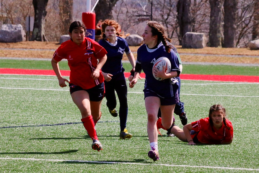 Emily Maynard races up the pitch with an AV teammate running in support. - Carole Morris-Underhill
