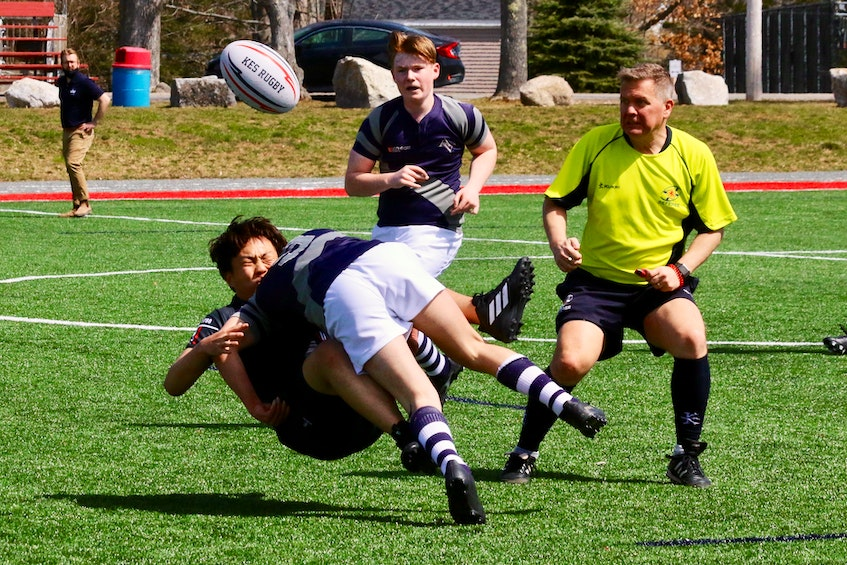 King's-Edgehill's Bruce Zhang braces for impact as he gets taken down by an Avon View player. - Carole Morris-Underhill